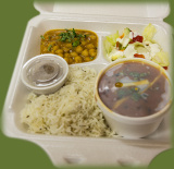 Take out box of great indian food. Basmatic rice, Indian Naan, Channa Masala, Garden Salad, and Curry garnished with fresh ginger and cilantro. Available for pick up take away take out, catering and delivery.